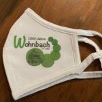 Mundschutz weiss, mit Wohnbach 1250 Logo